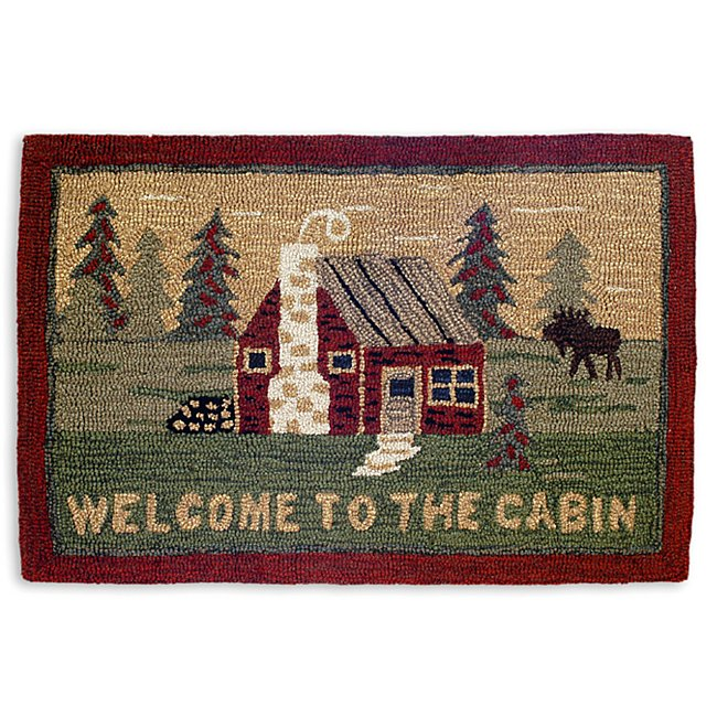 welcome mat with bright red cabin