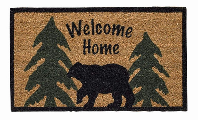 welcome mat with black bear and green pine trees