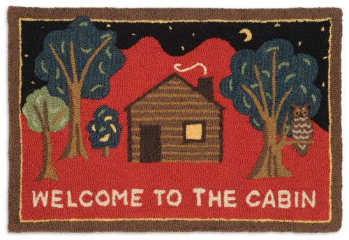 wool rug picturing a cozy cabin on a red mountain