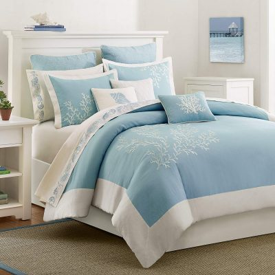 Pretty aqua coastal theme bedding with coral embroidery