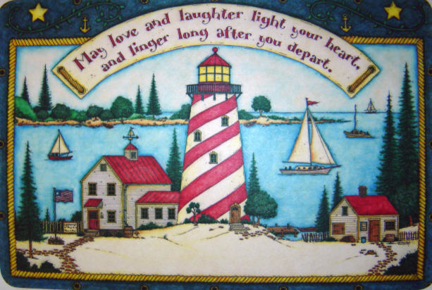 doormat depicting scenic lighthouse view with sailboats in the background on the water