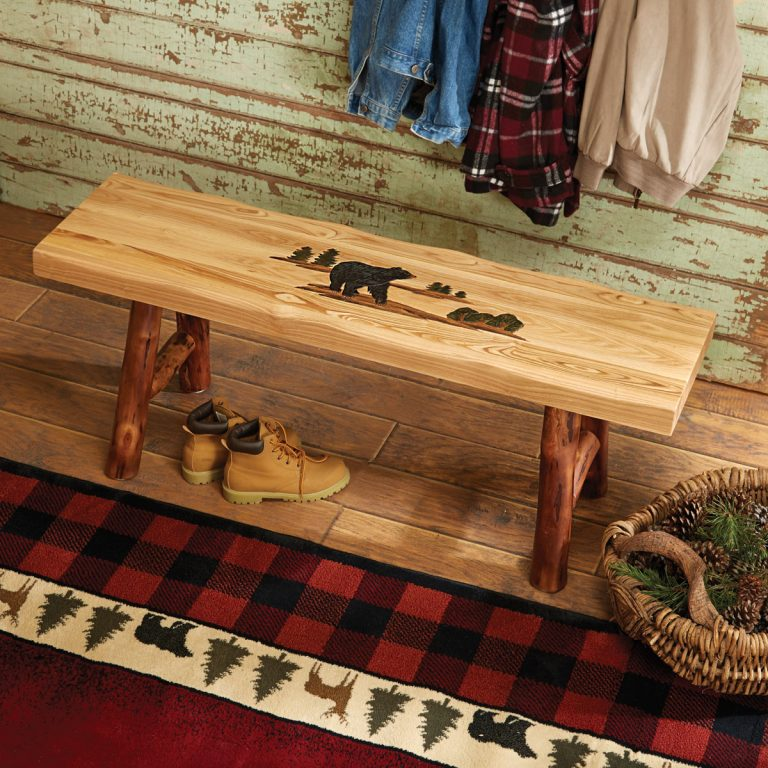 Bench with log legs and bear carvings