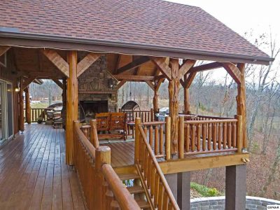 Railing made of logs on porch of log home