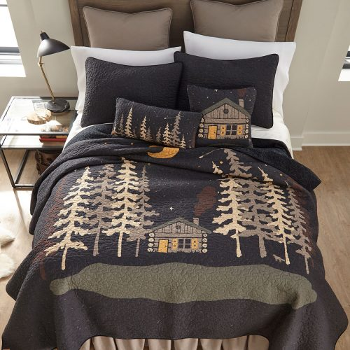 Midnight Cabin quilt with matching pillows