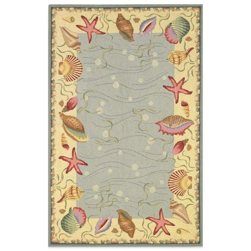 rug with lovely muted colors and seashells, starfish, conch shells and scallops.