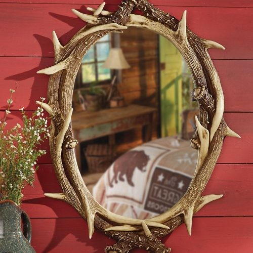 Oval mirror with faux antler frame
