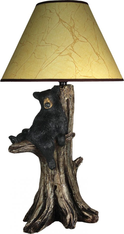 Sitting bear on a tree limb on table lamp