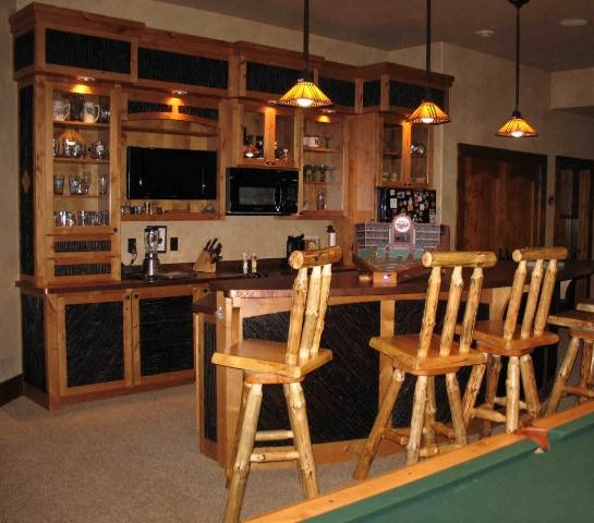 Bar area in log home, with pendant lights over the bar