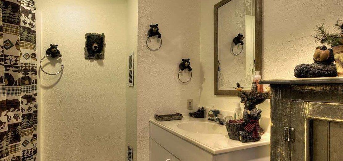 Bathroom with a bear bathroom decor theme
