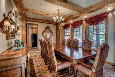 Dining room with antler chandelier and wall sconces