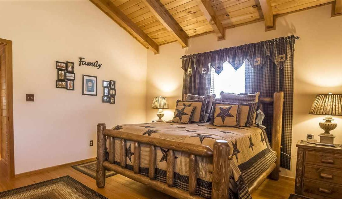 Curtain themes for log cabins include Western, like this bedroom