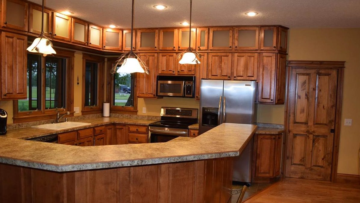 Log home kitchen with pendant light fixtures