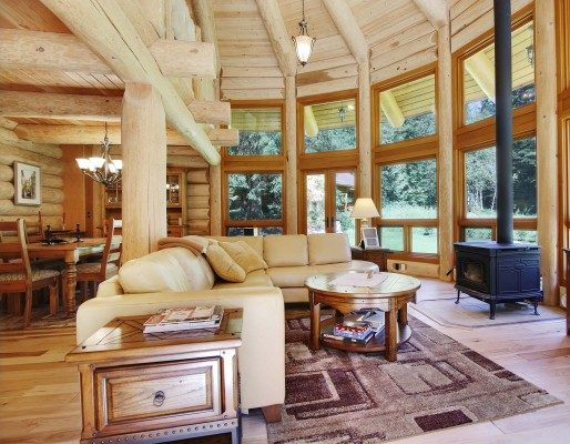 Log home living room with pendant light fixture