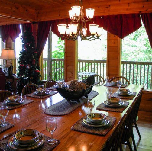 Rustic casual dinnerware on table in log cabin home